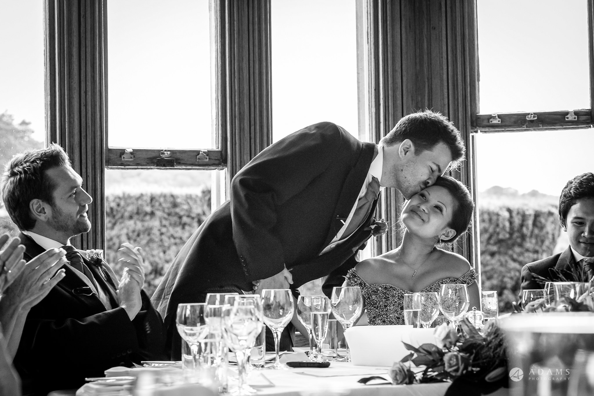 St Audries Park wedding groom kisses the bride