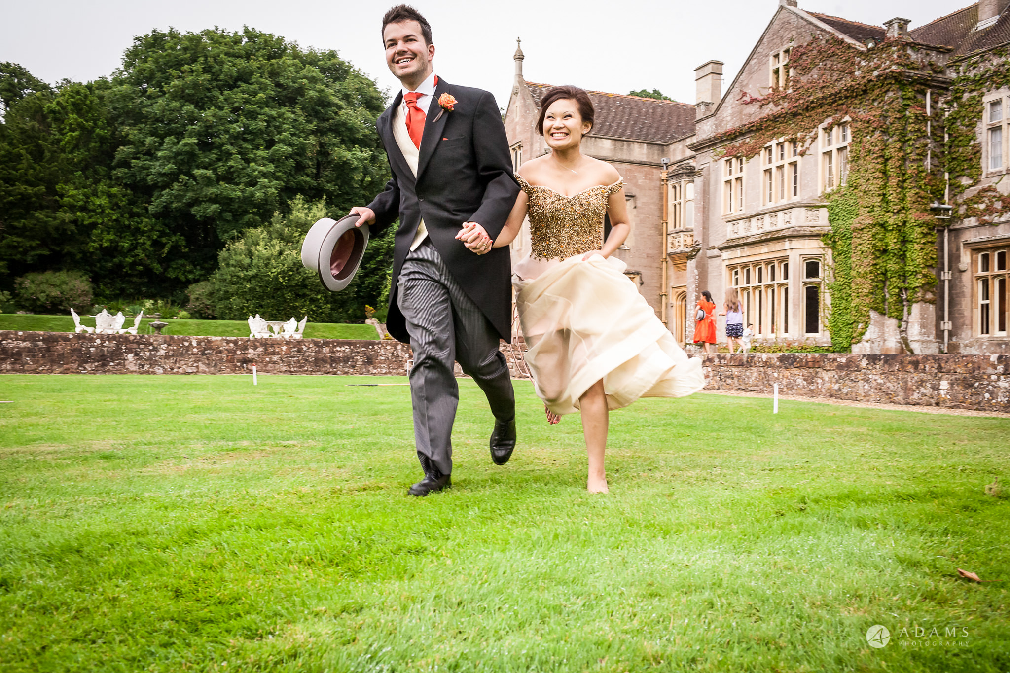 St Audries Park wedding couple running on the lawns