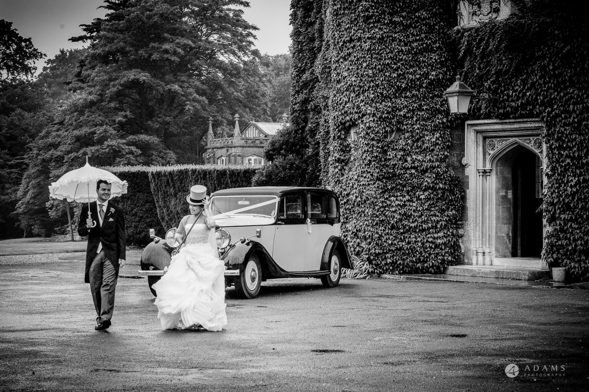 St Audries Park wedding couple walking next to their wedding car