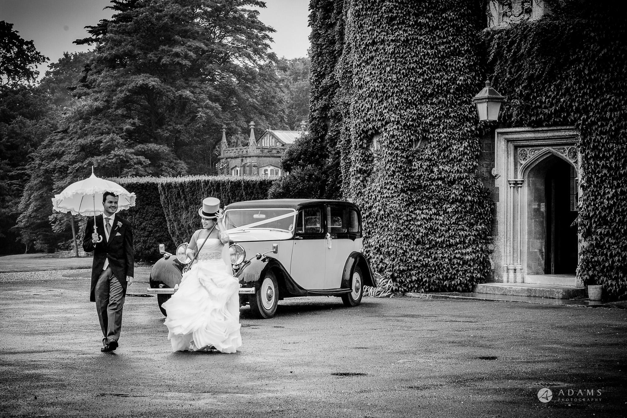 St Audries Park wedding couple walking next to their wedding car