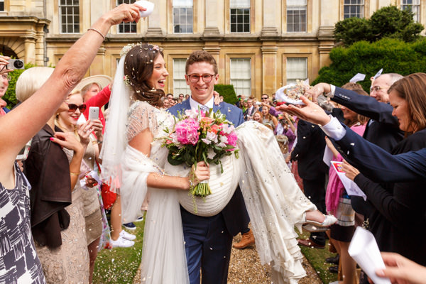 Wedding Photographer Hertfordshire bride and groom under confetti shower