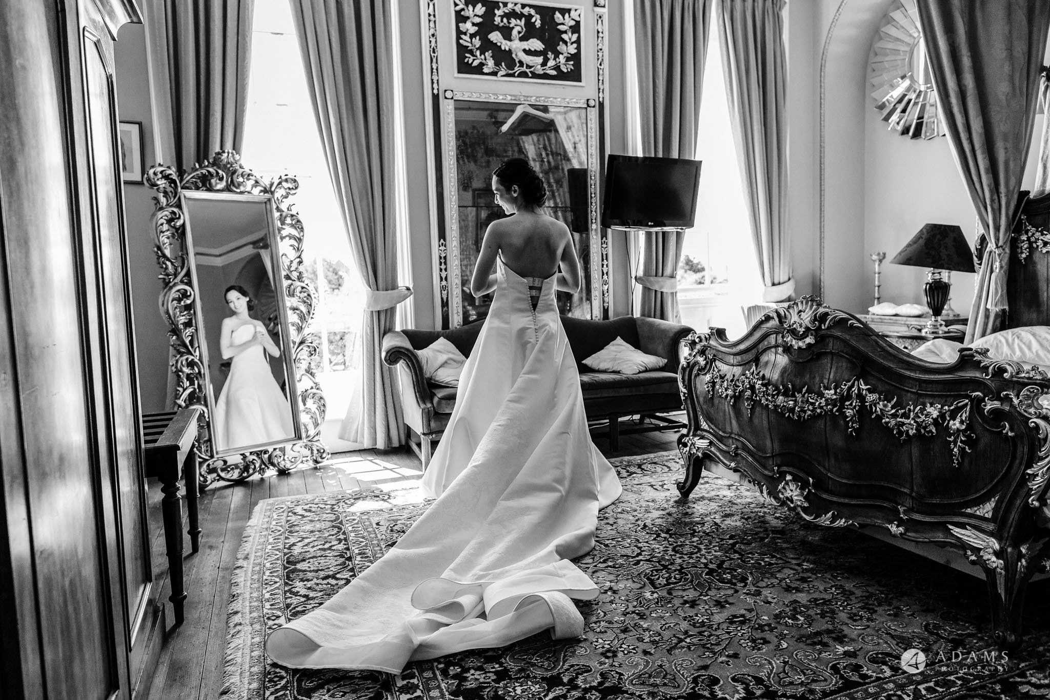 Trinity College Cambridge wedding bride getting in to the dress