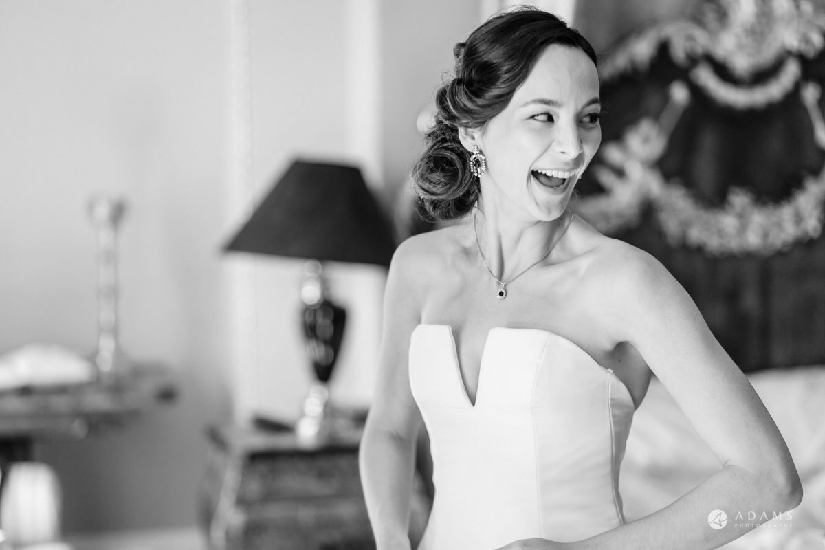 Trinity College Cambridge wedding bride laughing