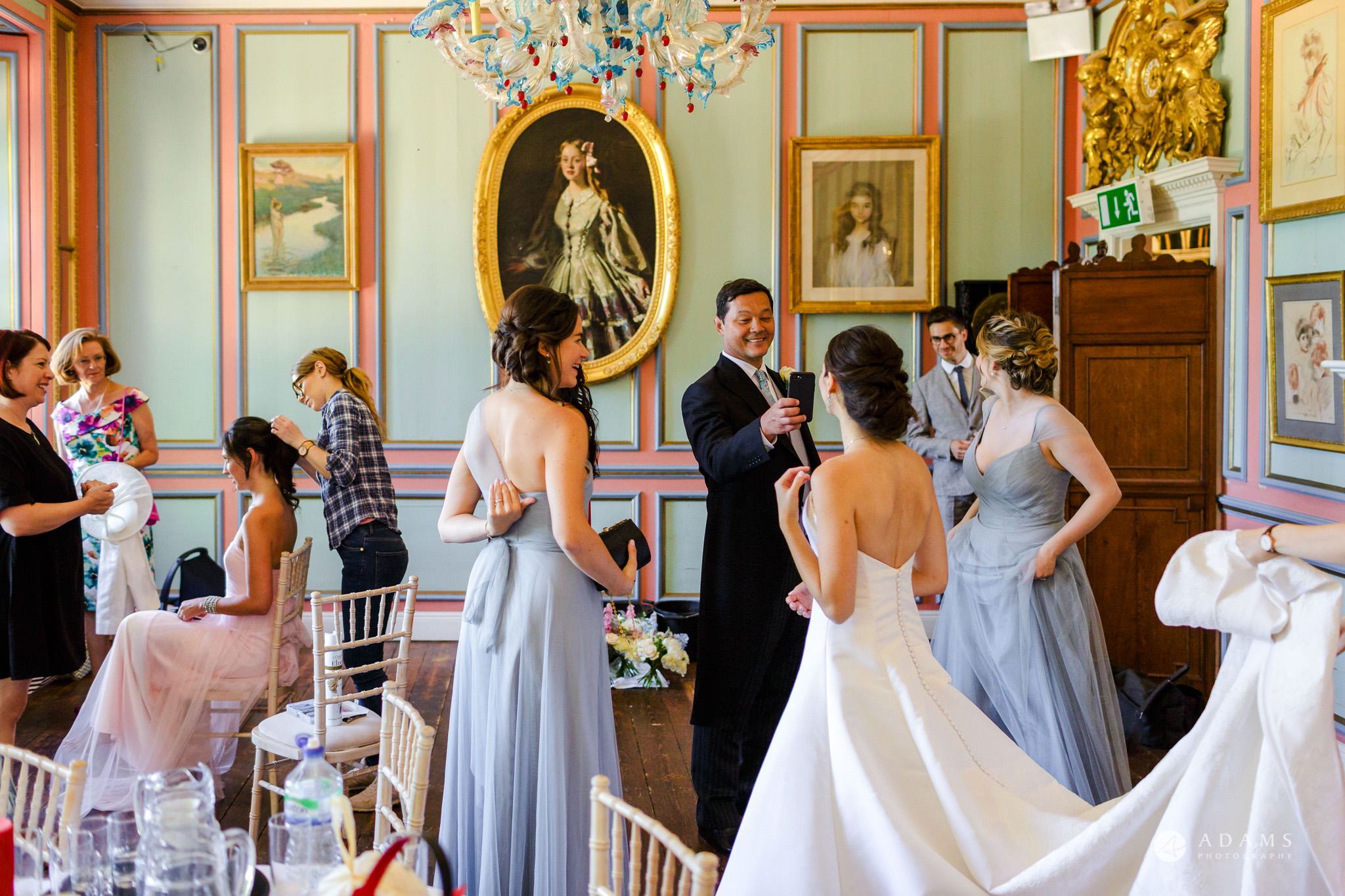 Trinity College Cambridge wedding father of the bride greets his daughter