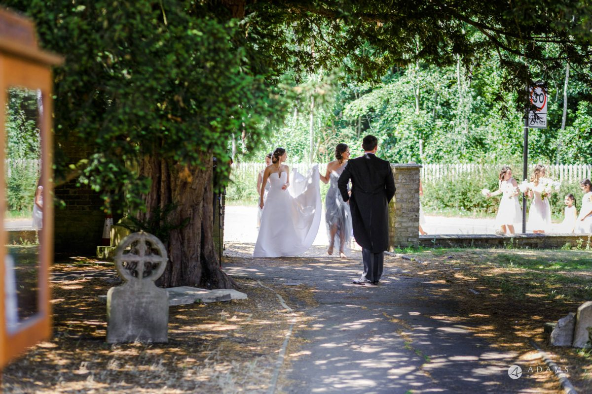 Trinity College Cambridge wedding bride walks to the church