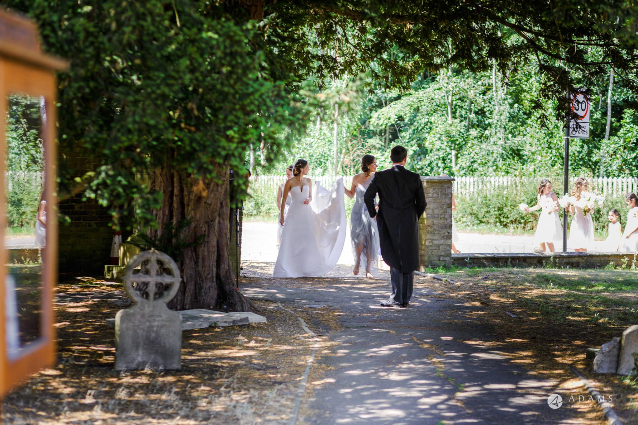 Trinity College Cambridge wedding bride walks to the church