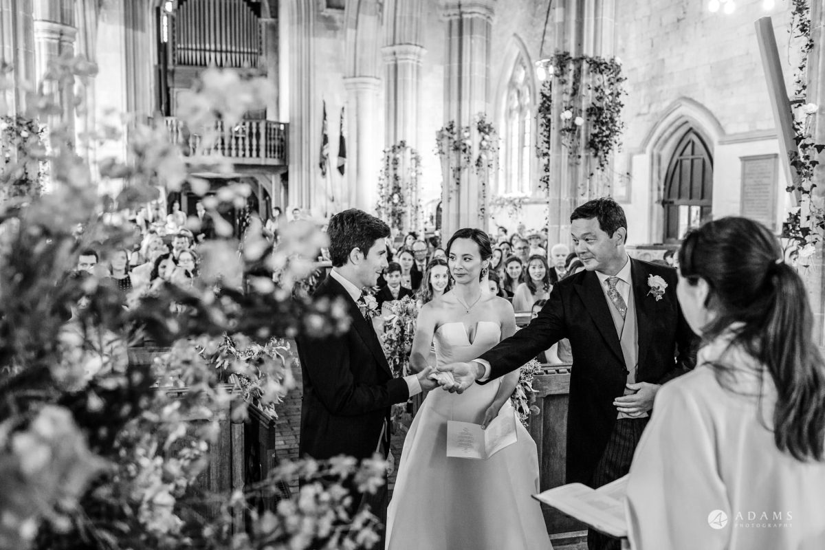 Trinity College Cambridge wedding father give his daughter hand to the groom