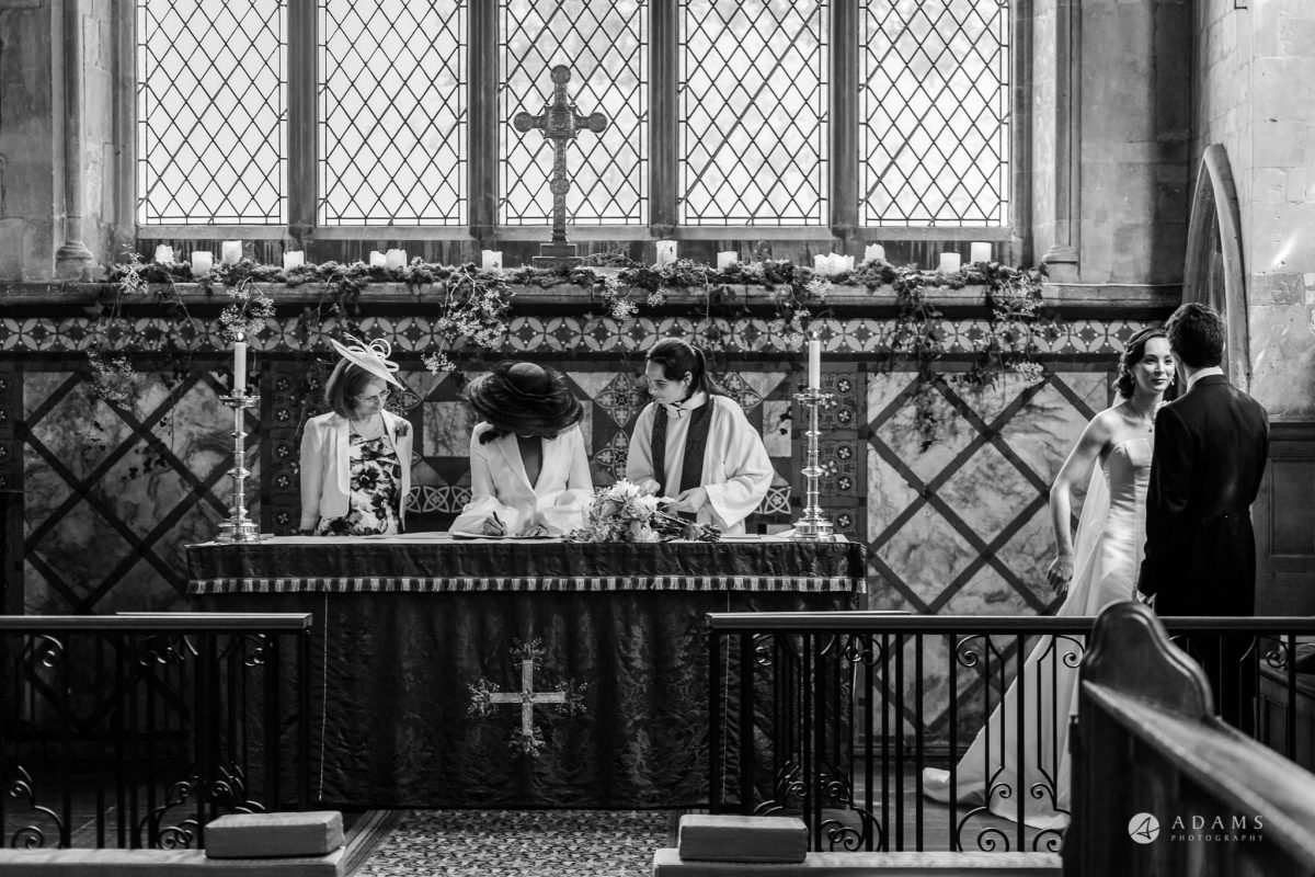 Trinity College Cambridge wedding sining the registrar