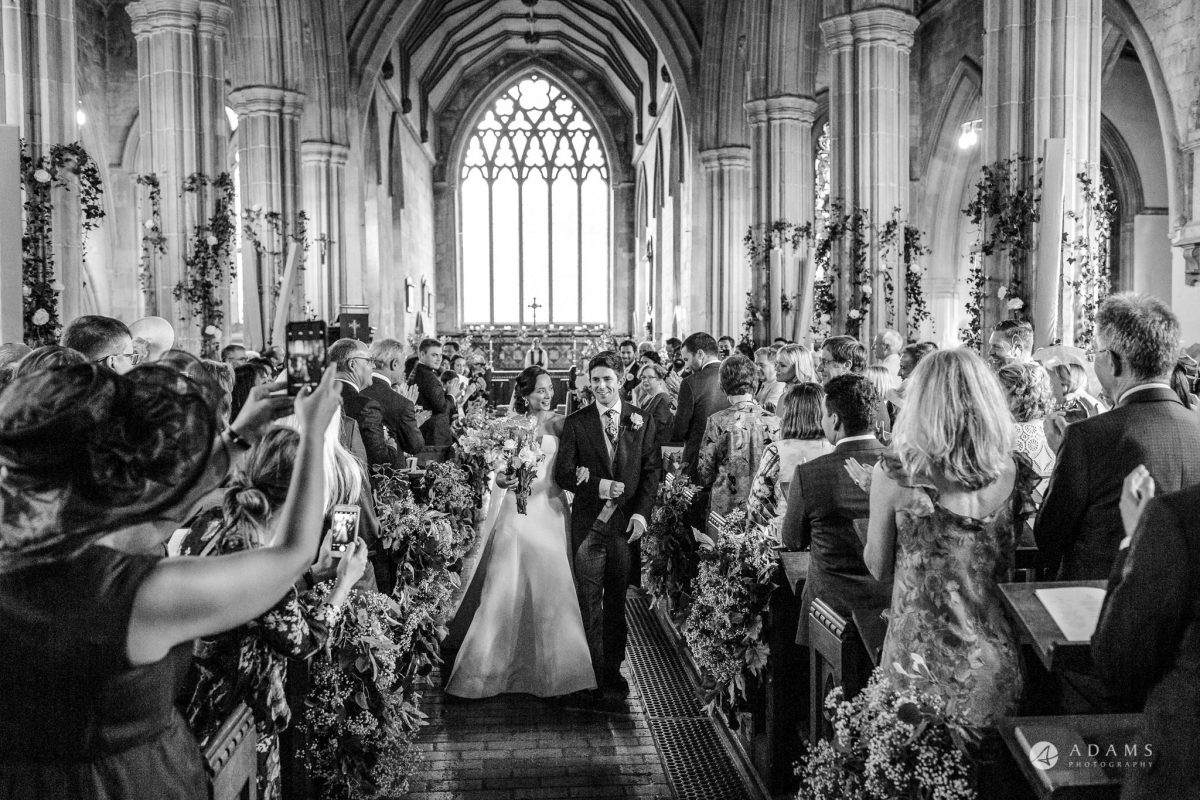Trinity College Cambridge wedding bride and groom leave the church
