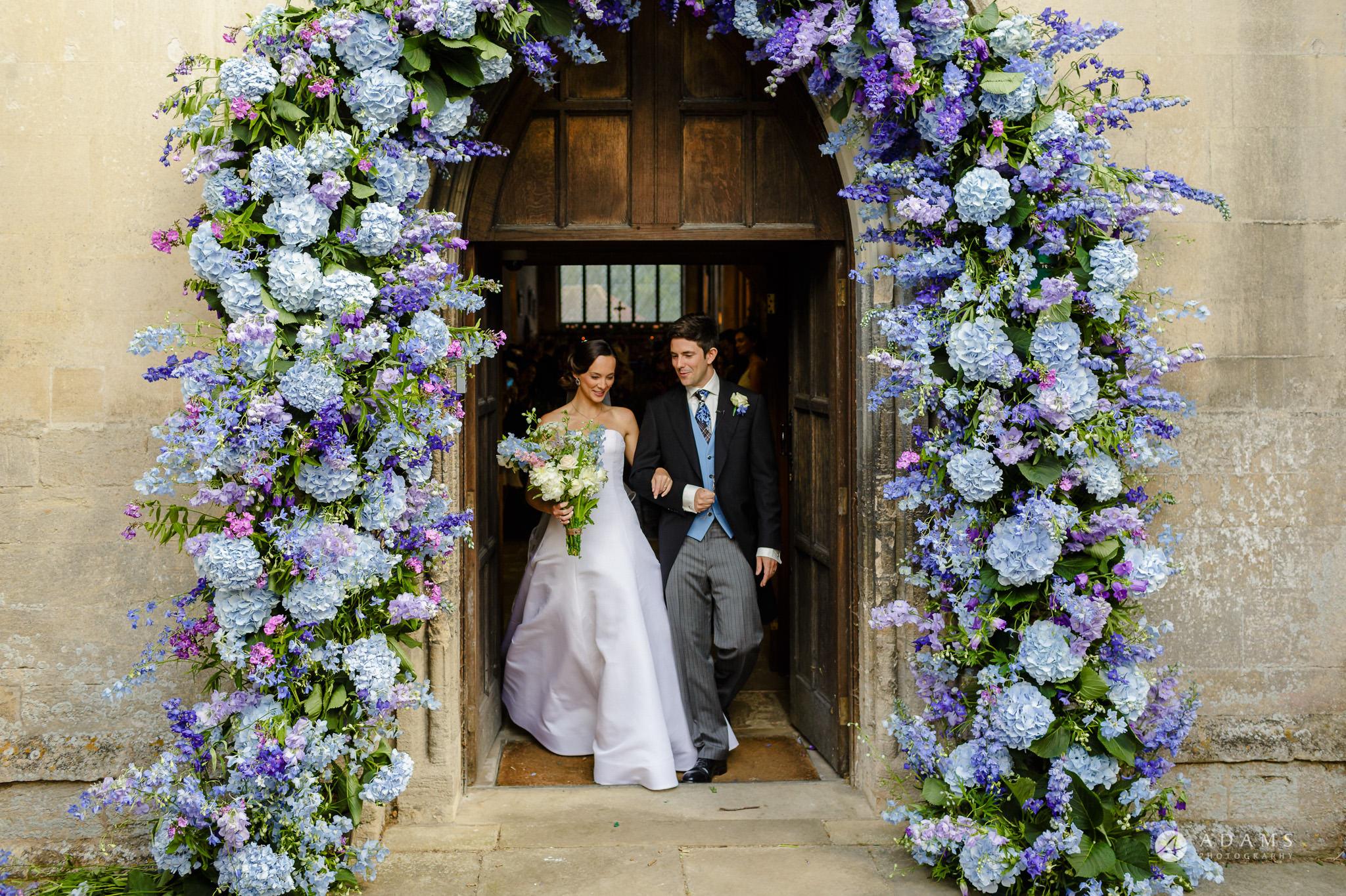 Trinity College Cambridge wedding bride and groom exit the church