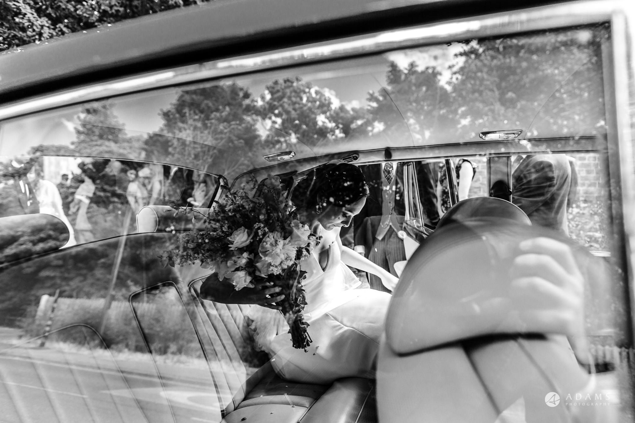 Trinity College Cambridge wedding bride getting into the car