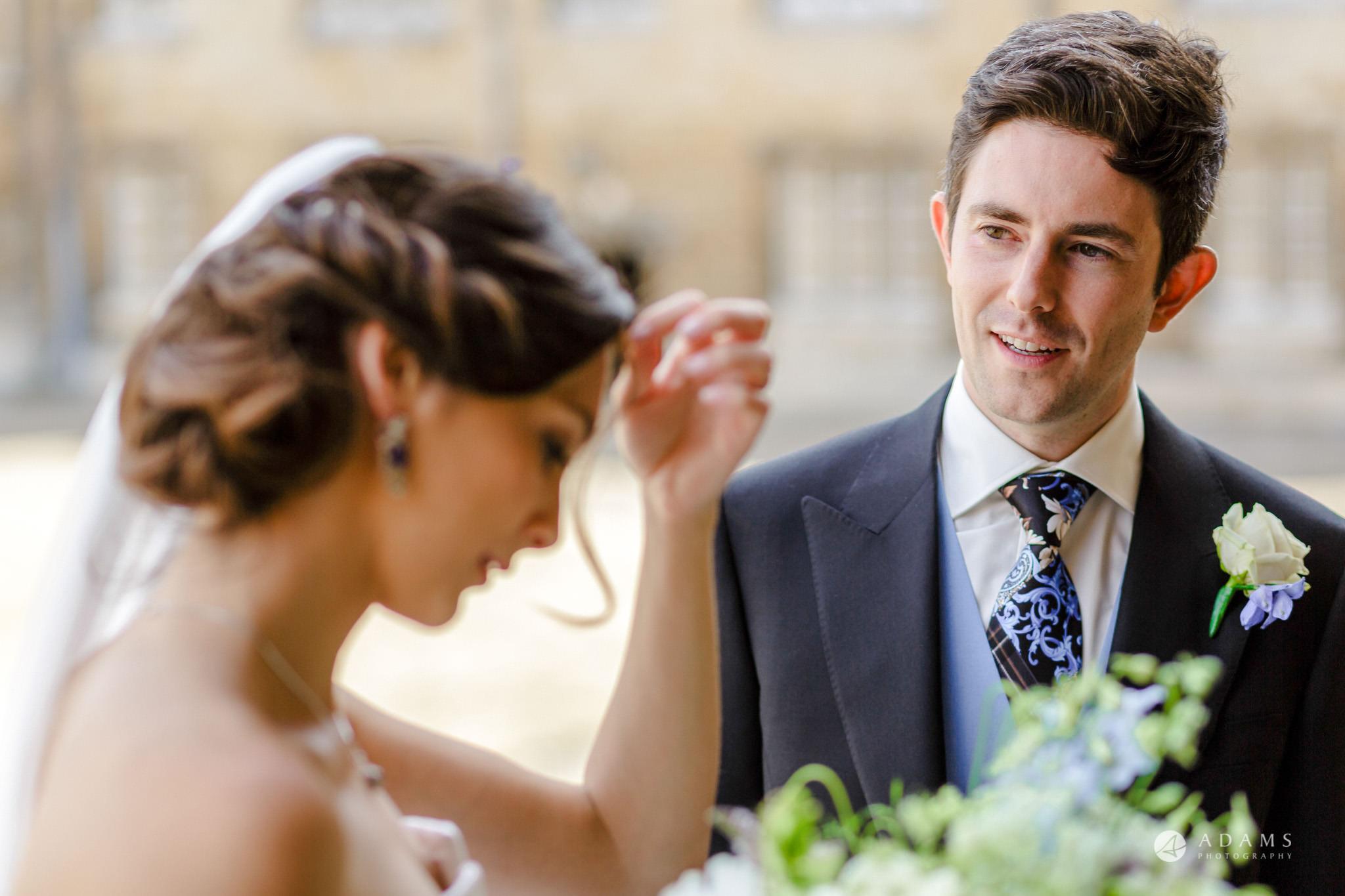 Trinity College Cambridge wedding bride and groom private moment