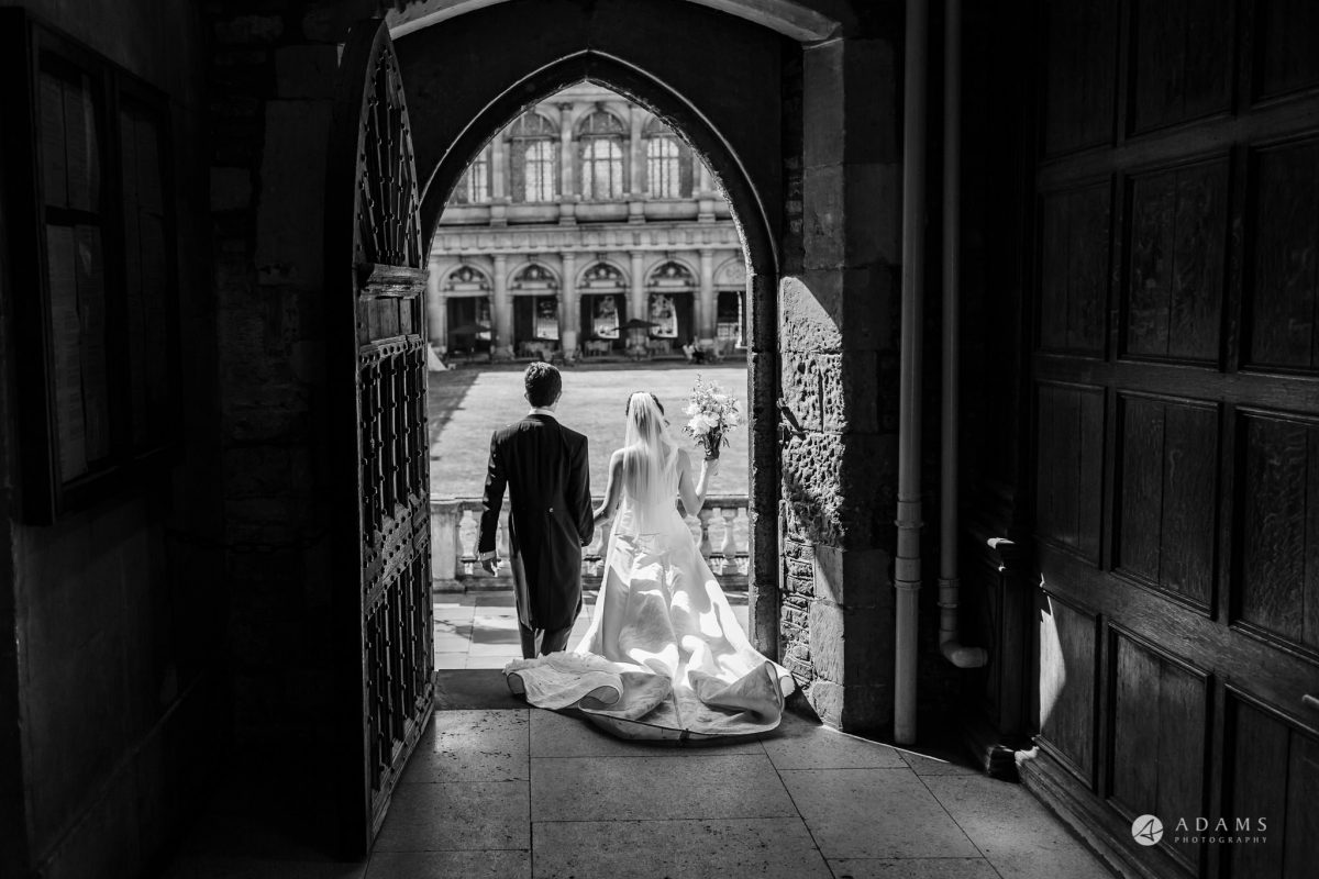 Trinity College Cambridge wedding married couple enter the courtyard