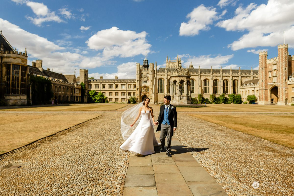 Trinity College Cambridge wedding couple walking in the university courtyard