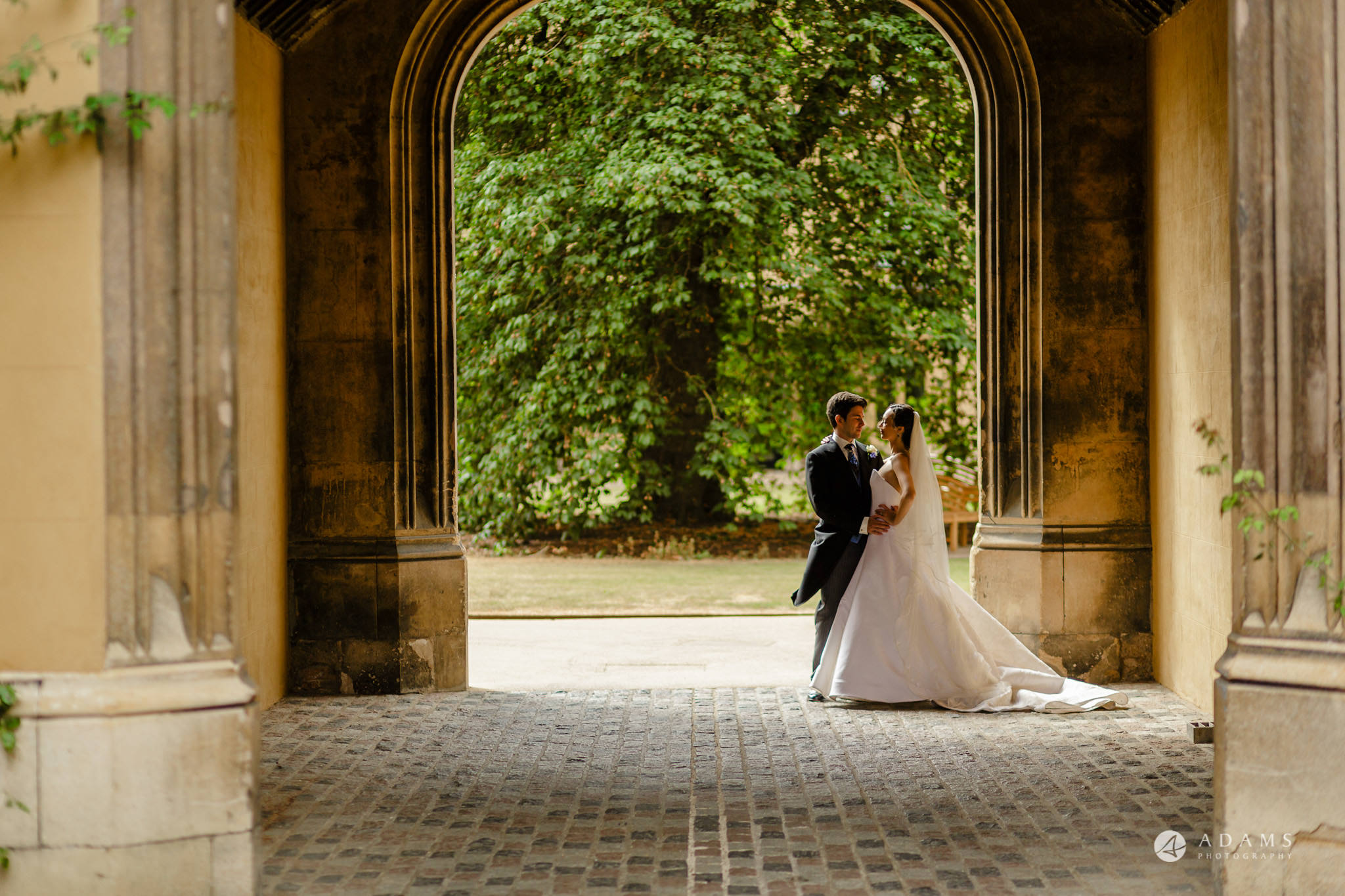Trinity College Cambridge wedding moment in the archway