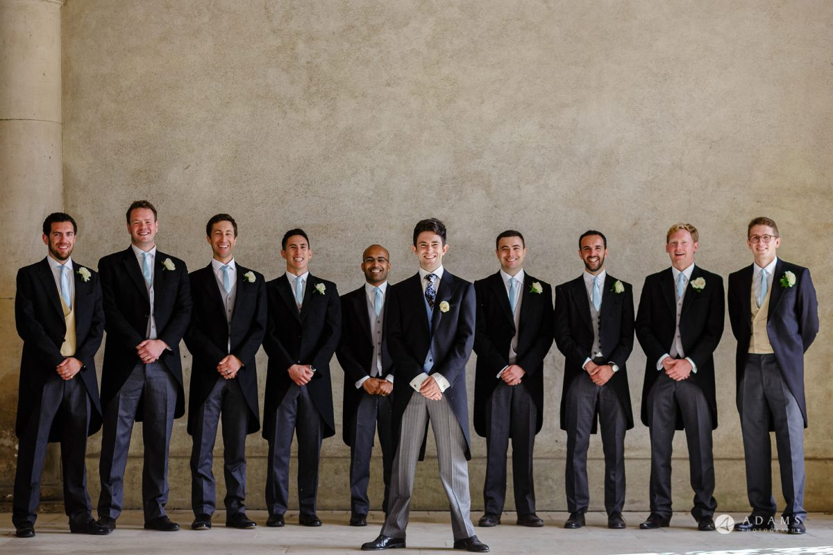 Trinity College Cambridge wedding groom and groomsmen group photo