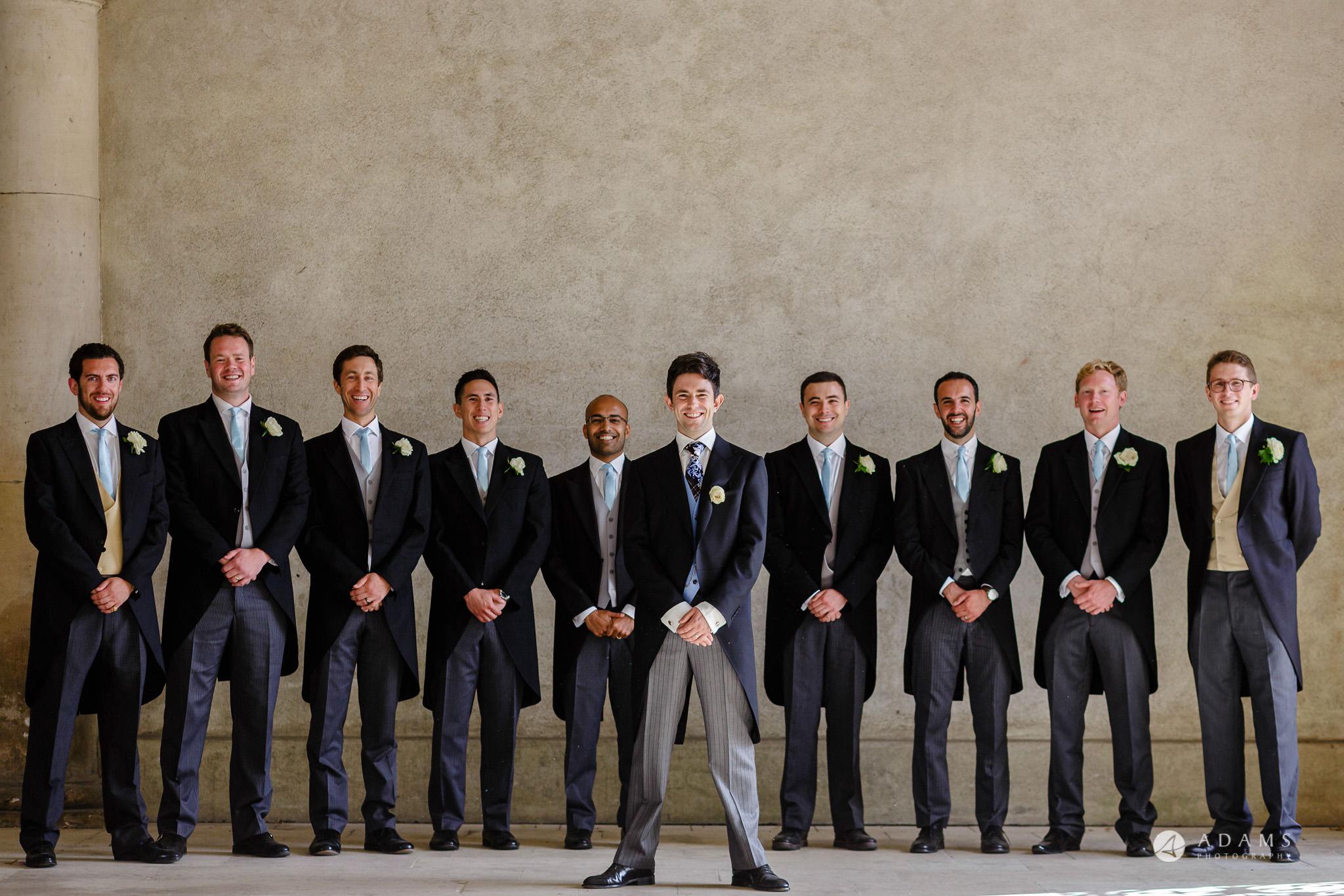 Trinity College Cambridge wedding groom and groomsmen group photo