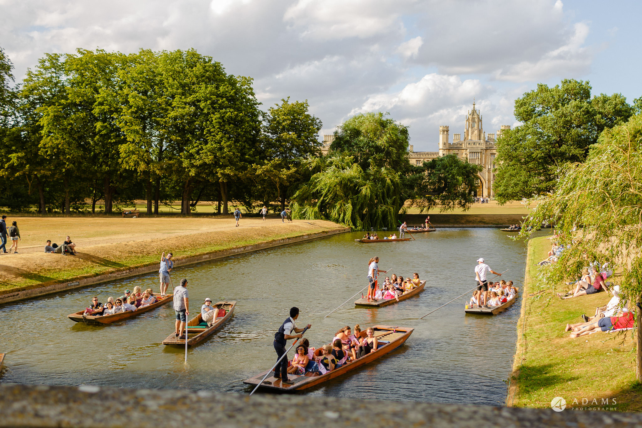 Trinity College Cambridge wedding university boats in the canal