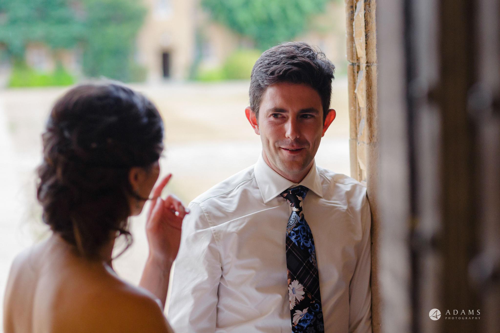 Trinity College Cambridge wedding couple cahtting
