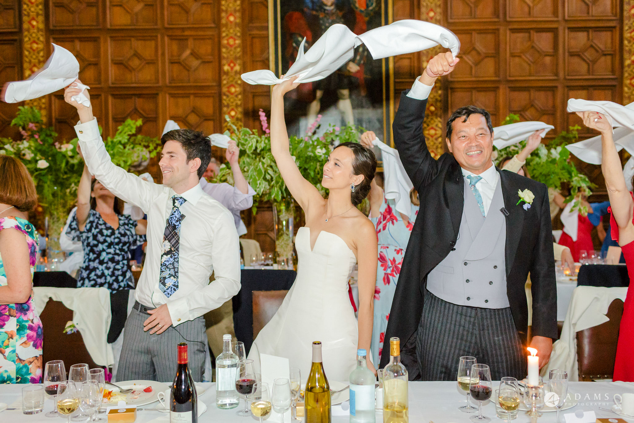 Trinity College Cambridge wedding hands in the aire