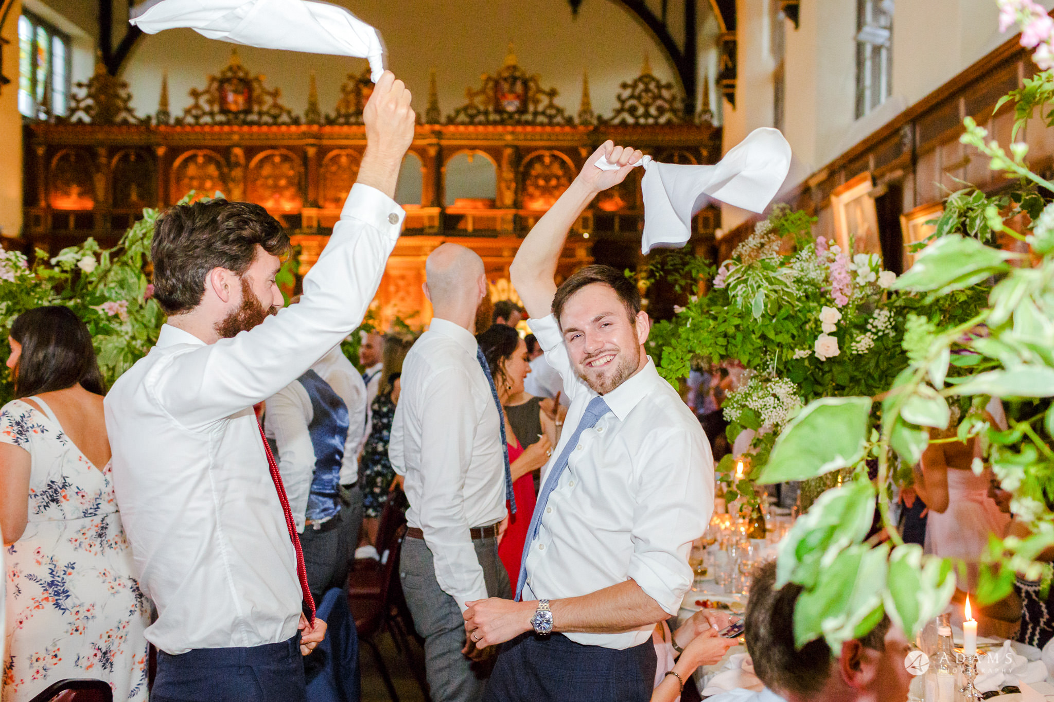 Trinity College Cambridge wedding guests waving