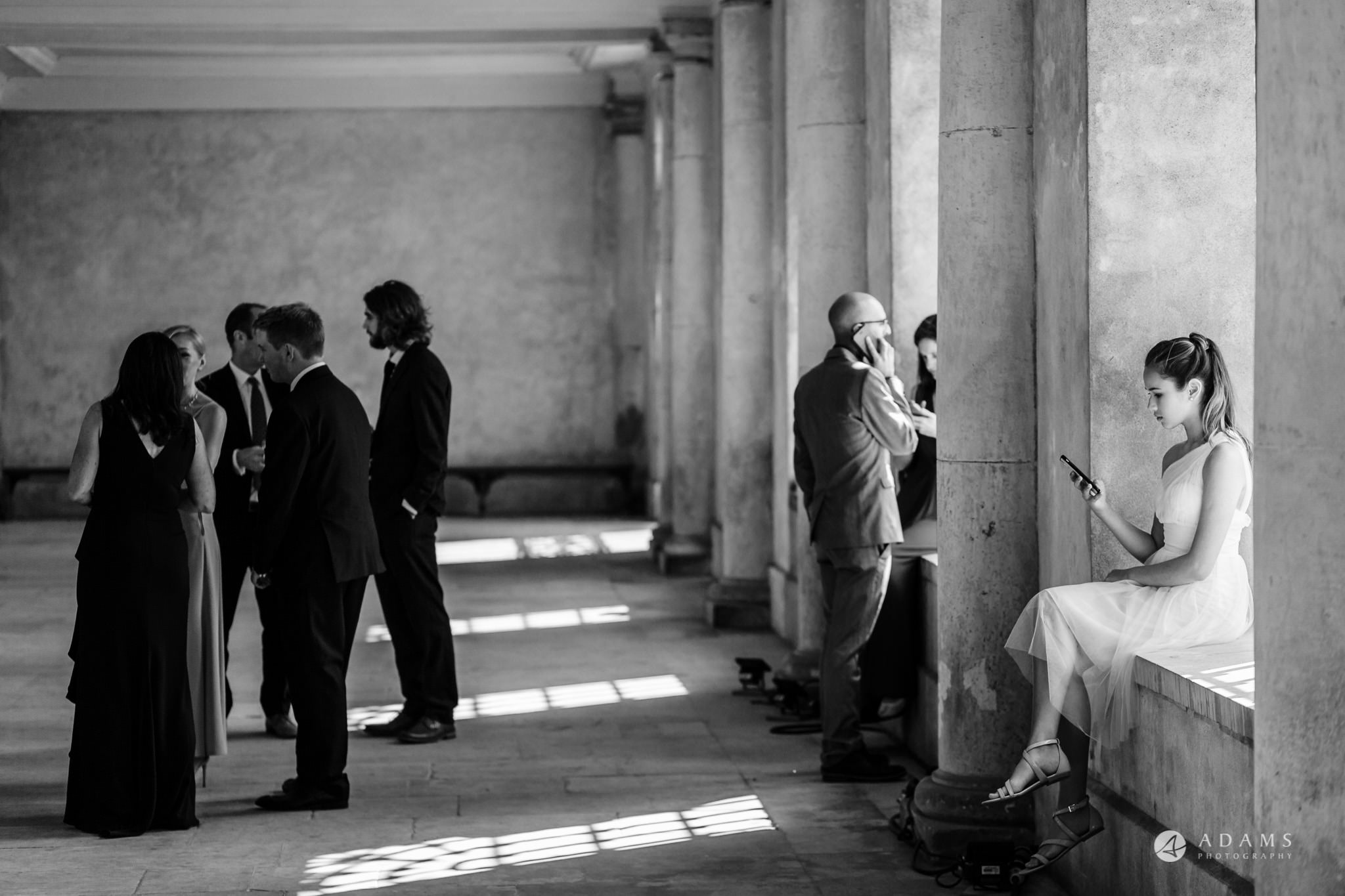 Trinity College Cambridge wedding guests in the reception area