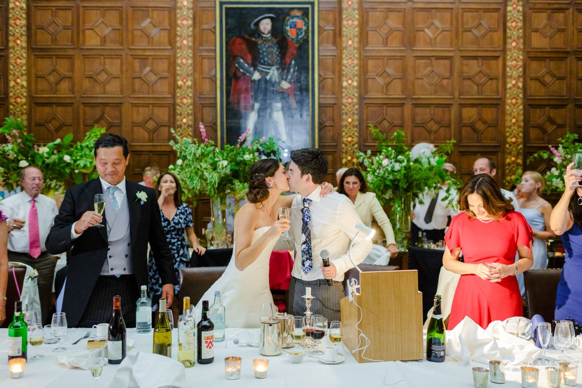 Trinity College Cambridge wedding bride and groom kiss