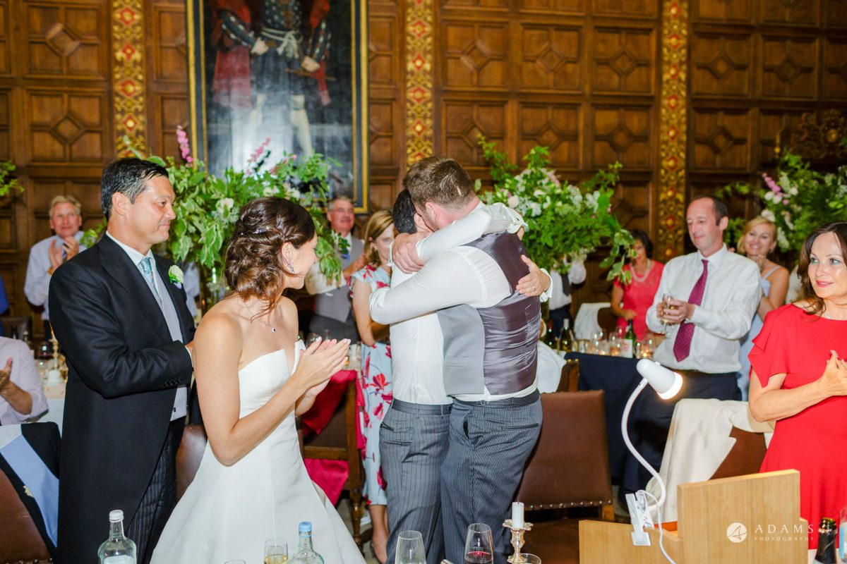 Trinity College Cambridge wedding groom hugs his best-man