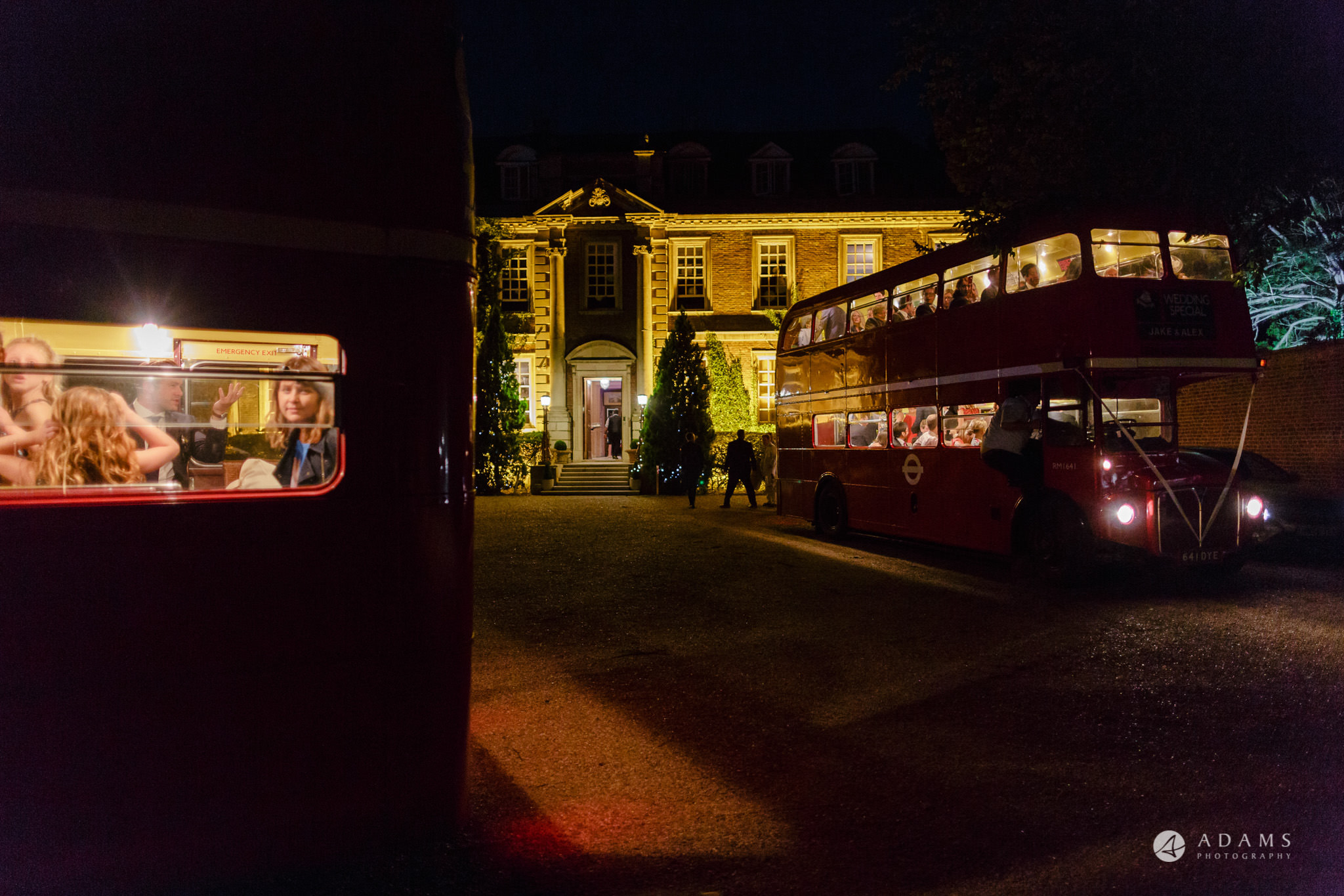 Trinity College Cambridge wedding busses arrive to the evening party hall