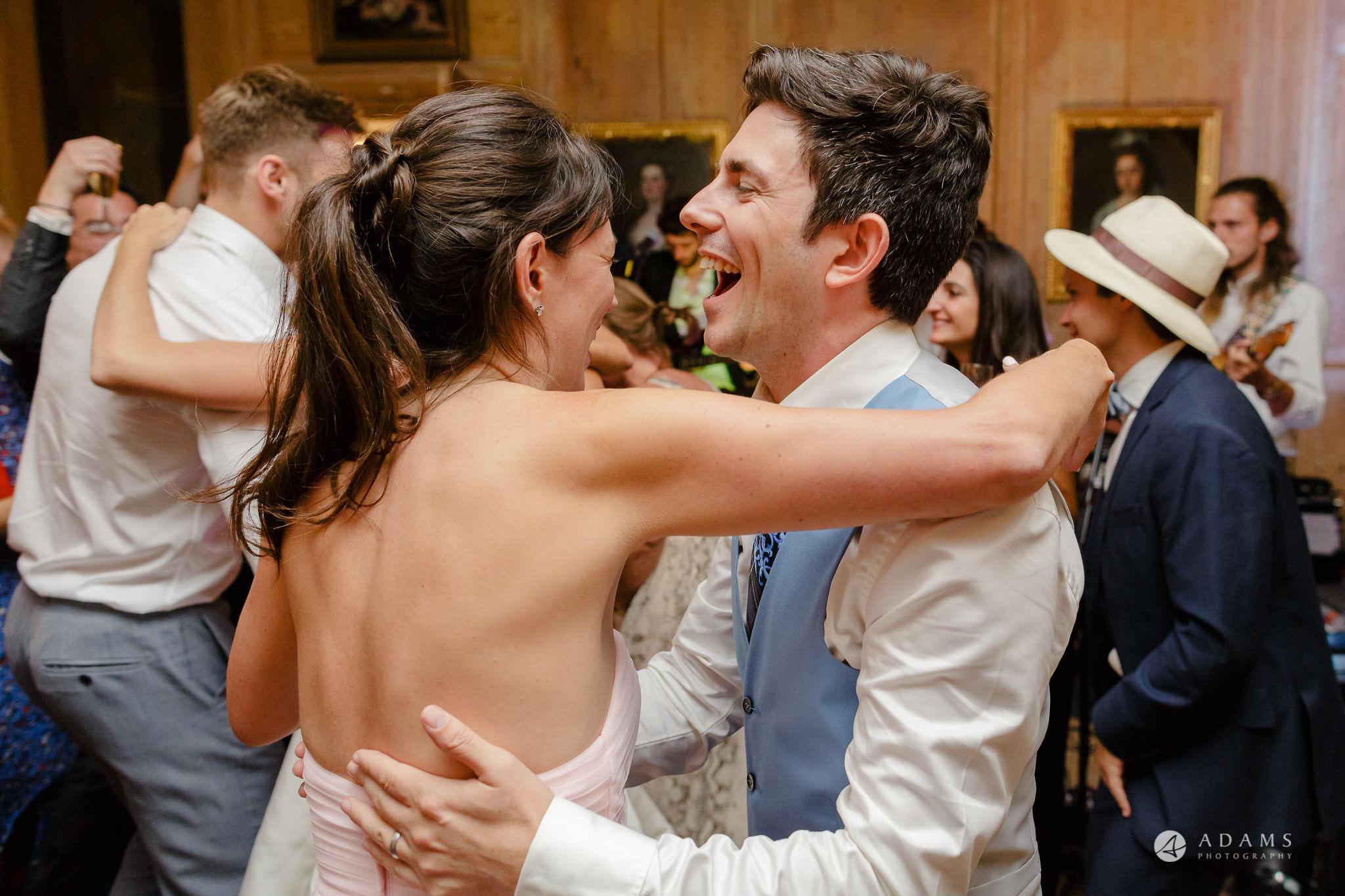 Trinity College Cambridge wedding groom dances with his sister