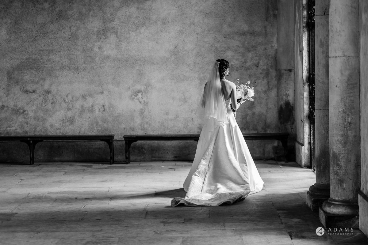 Trinity College Cambridge wedding bride walks away