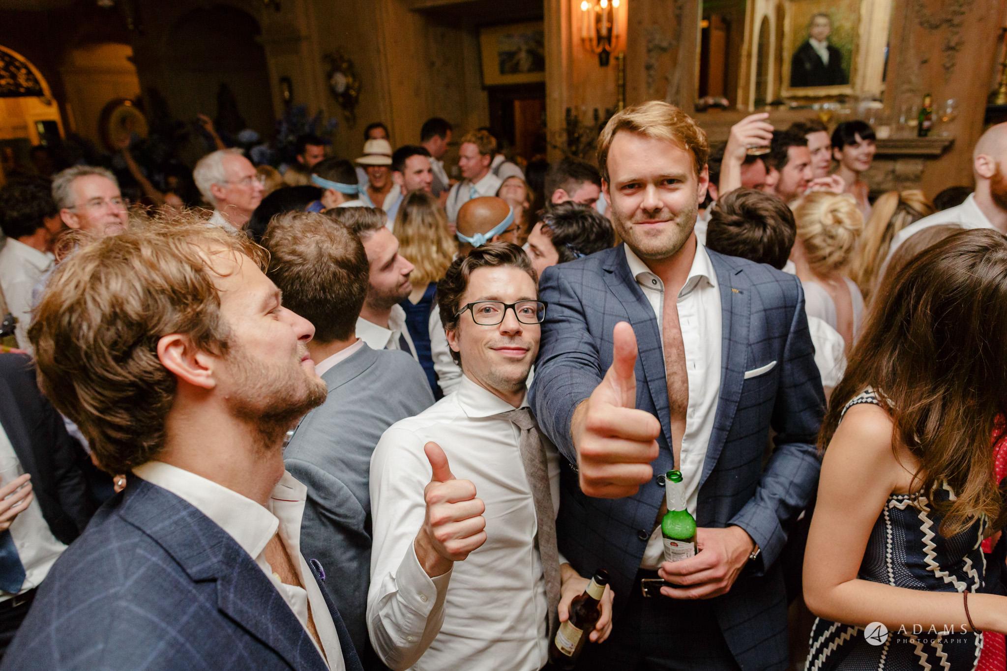 Trinity College Cambridge wedding thumbs up