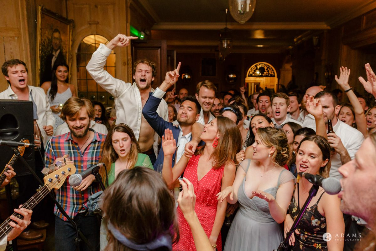 Trinity College Cambridge wedding crowd dances