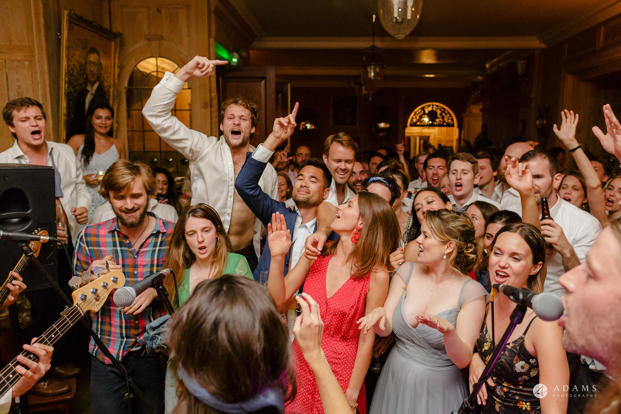 Trinity College Cambridge wedding crowd dances