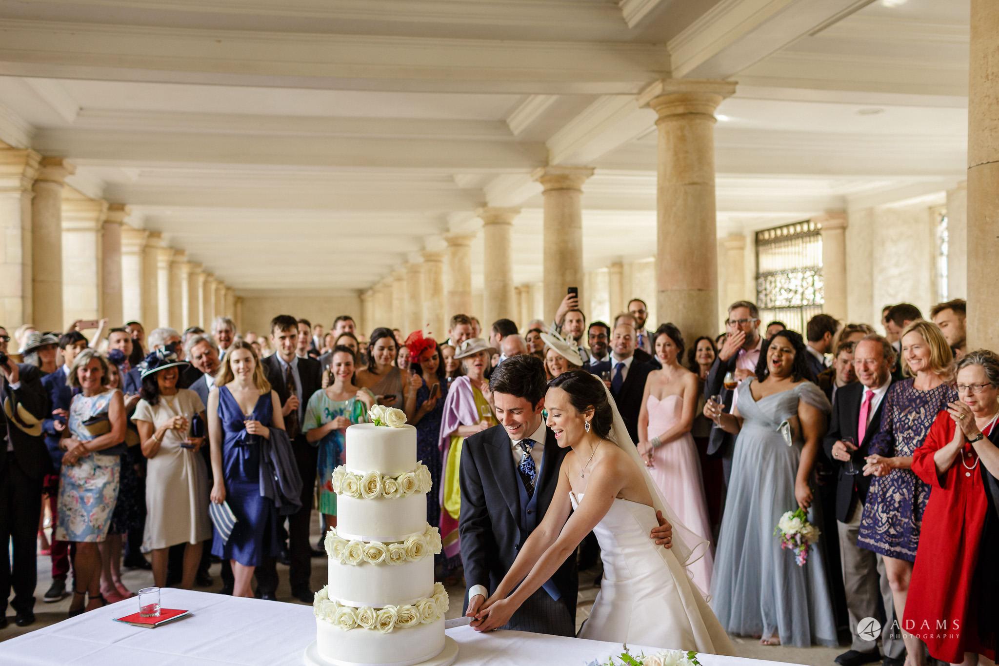 Trinity College Cambridge wedding cake cutting