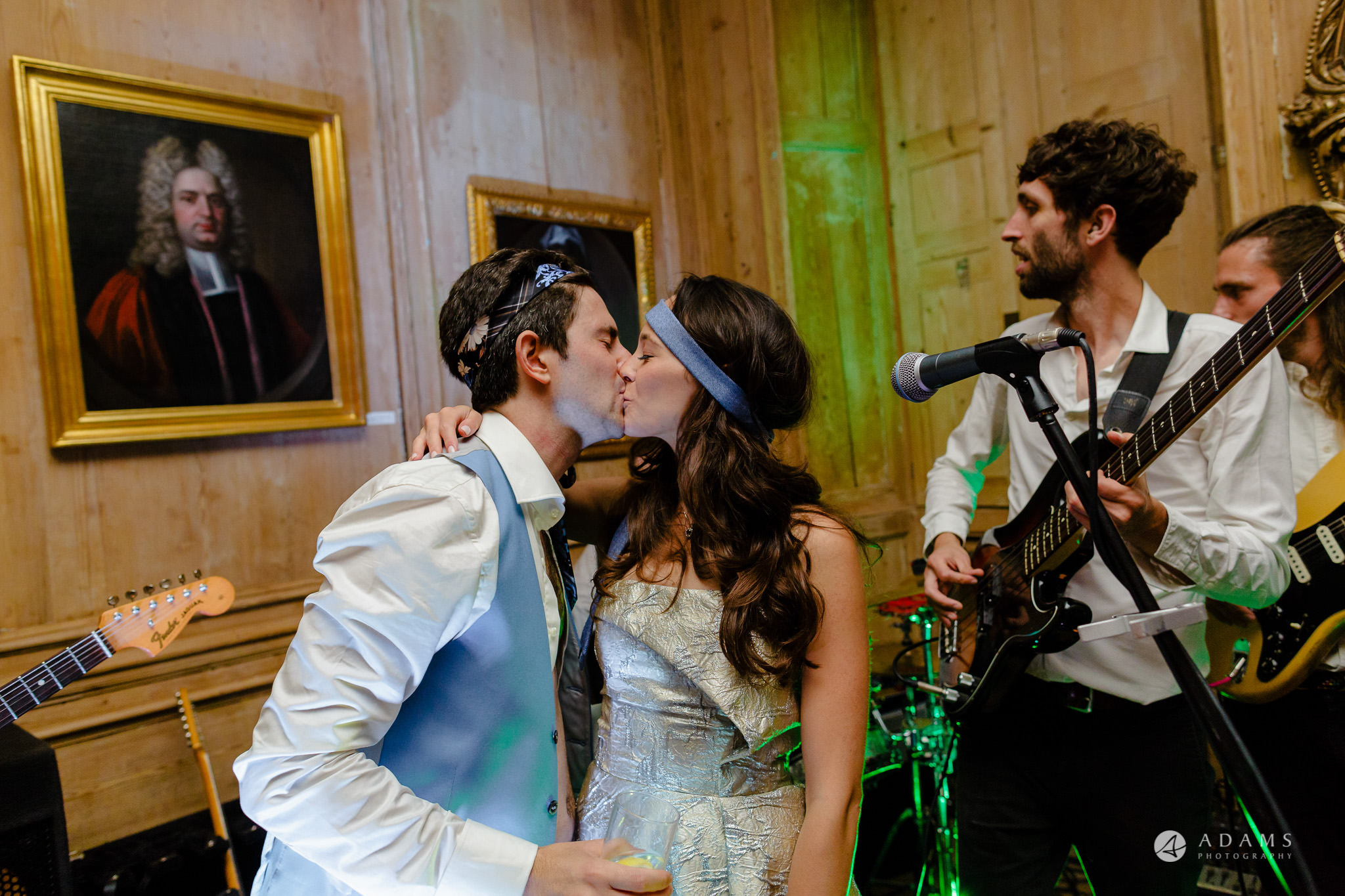 Trinity College Cambridge wedding bride and groom kiss during the party
