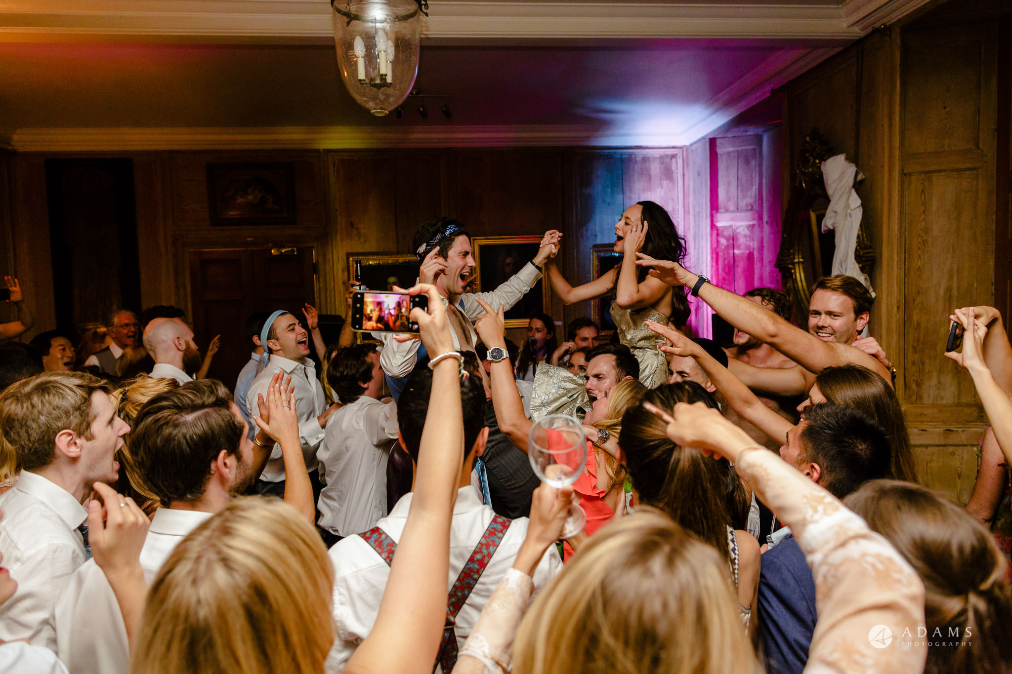 Trinity College Cambridge wedding bride and groom in the air