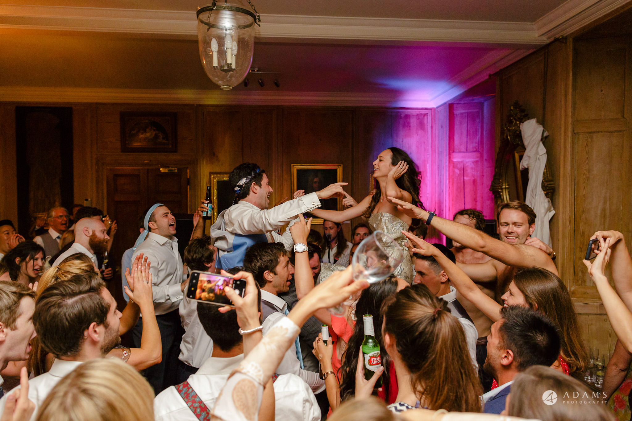 Trinity College Cambridge wedding married couple in the air