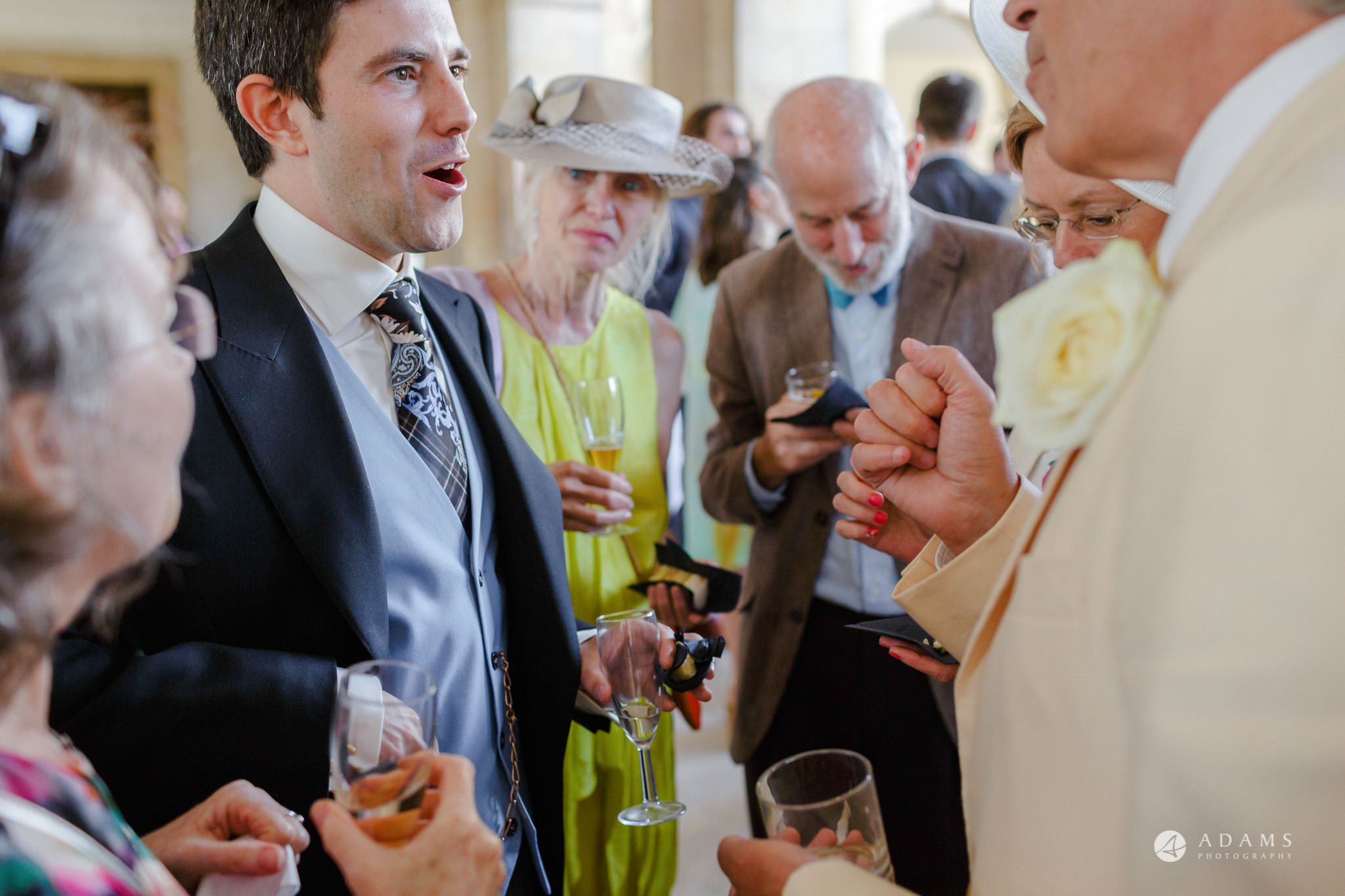 Trinity College Cambridge wedding groom chats with the guests