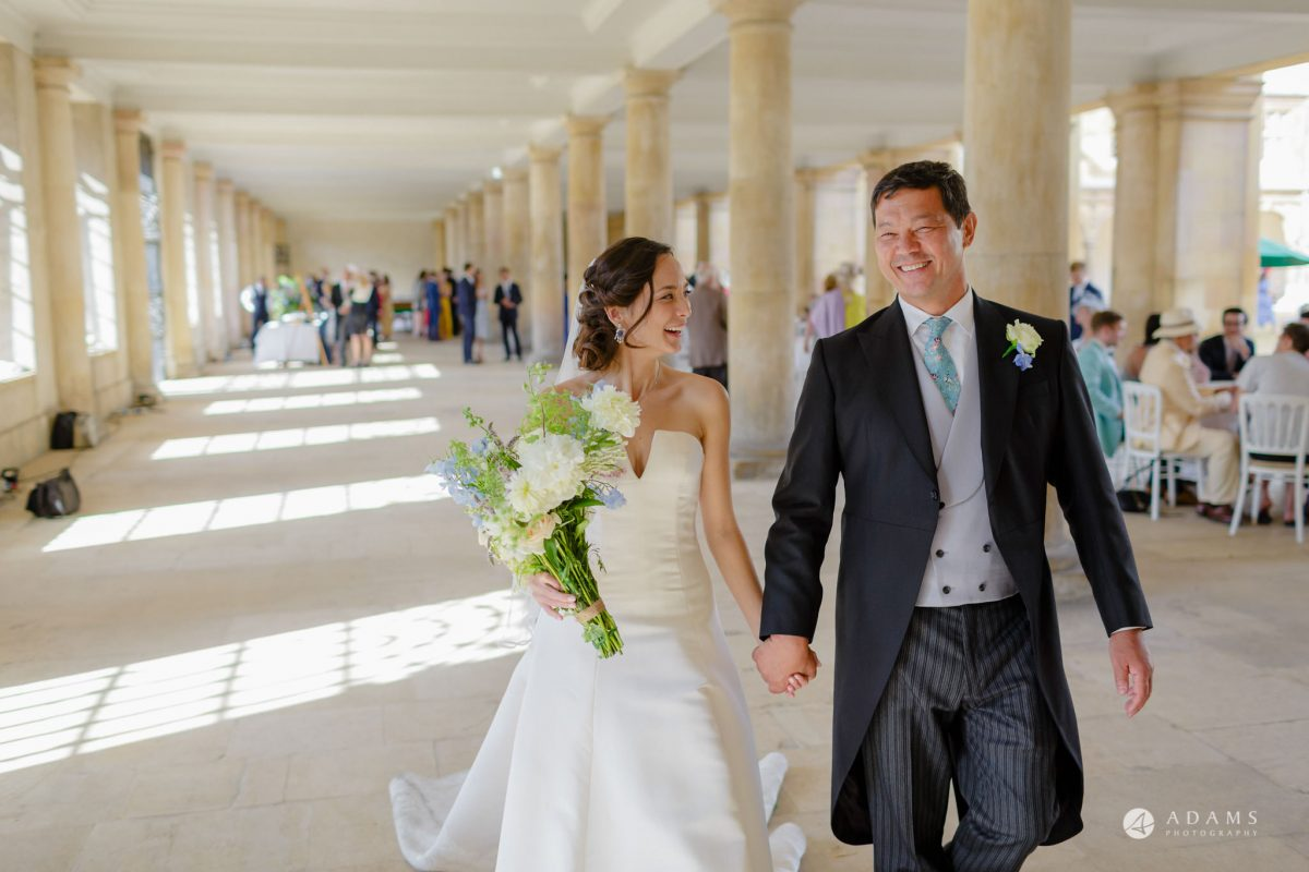 Trinity College Cambridge wedding bride walks with her father