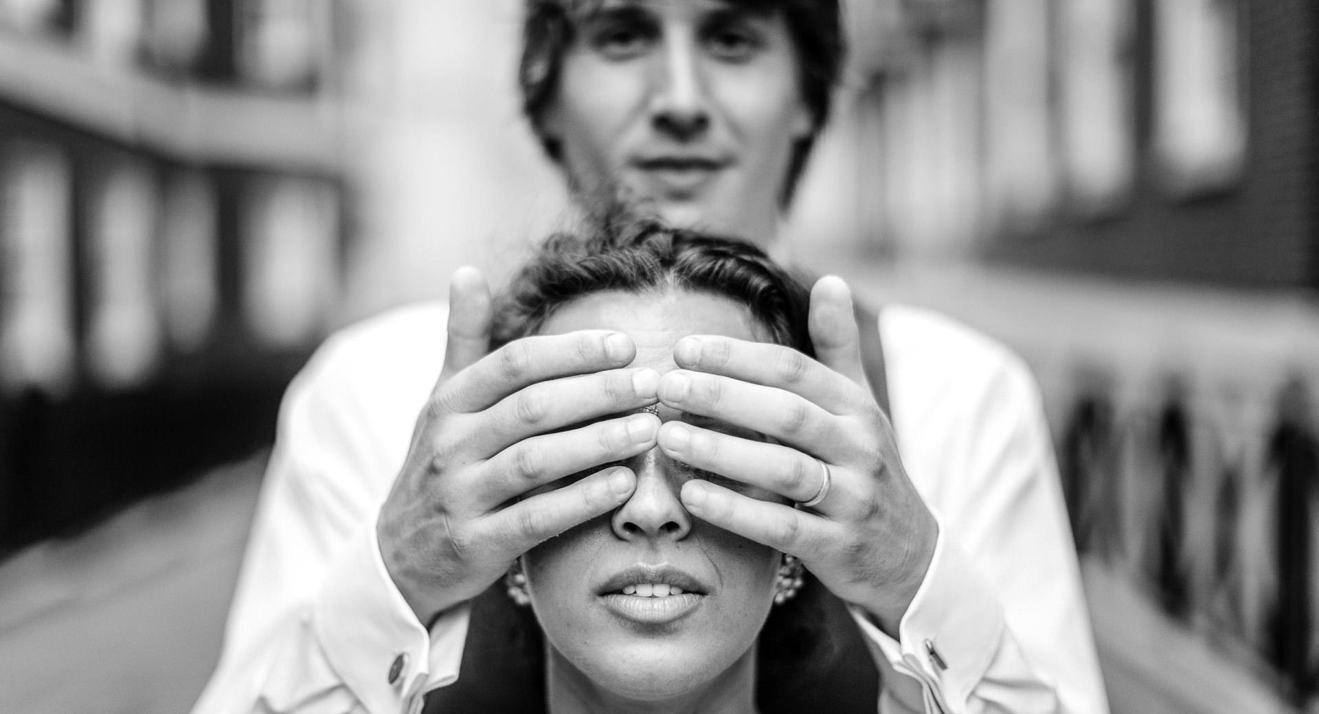 Wedding Photographer London groom holds hand on brides eyes