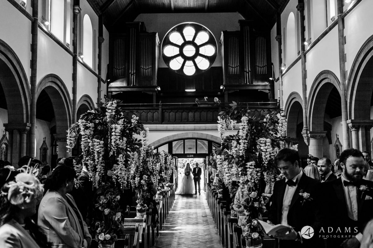black and white wedding photography bride walks down the isle