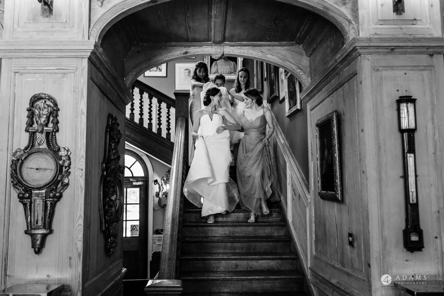 bride and bridal party waling down the stairs
