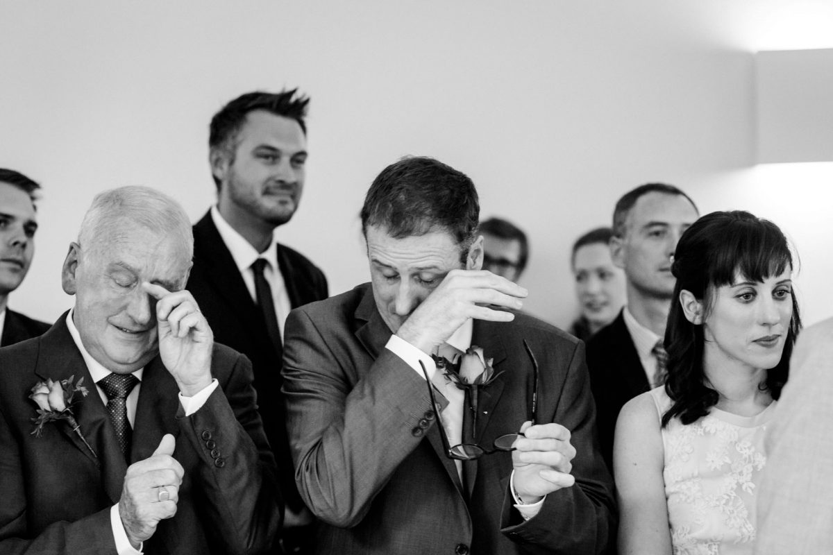 black and white wedding photographer guests crying