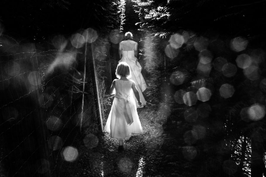 black and white wedding photographer bride and flower girl