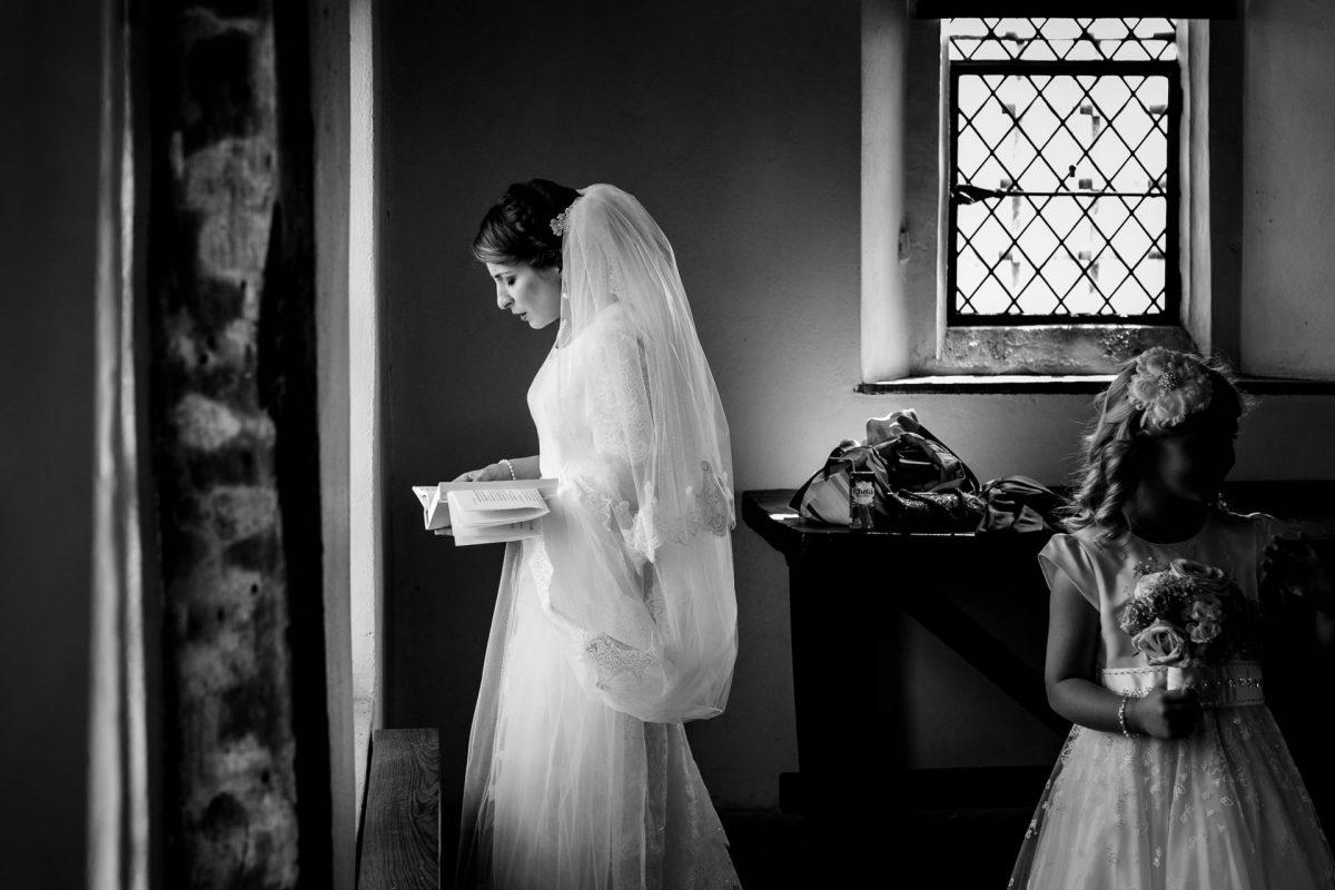 black and white wedding photographer bride praying