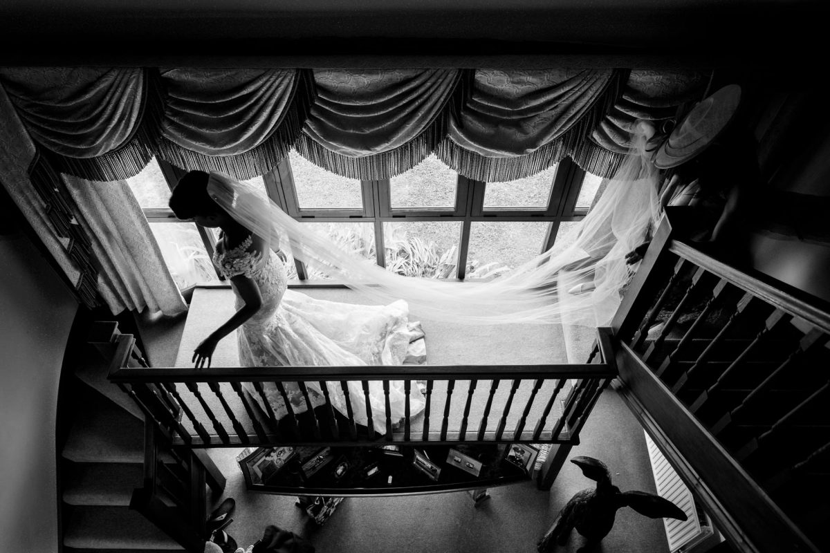 black and white bride walking down the stairs