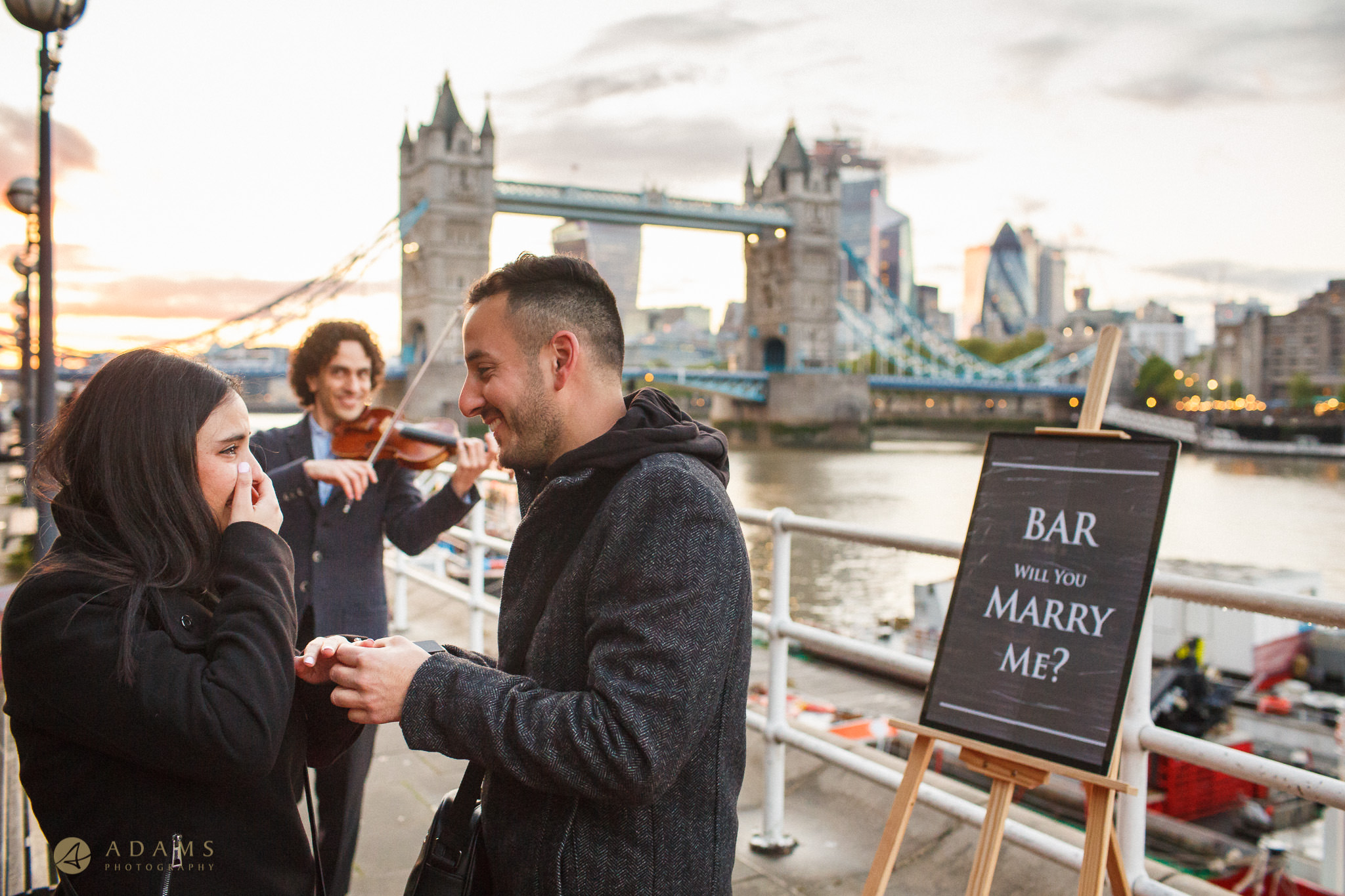 Proposal photo session in London by Tower Bridge fiancé surprise reaction