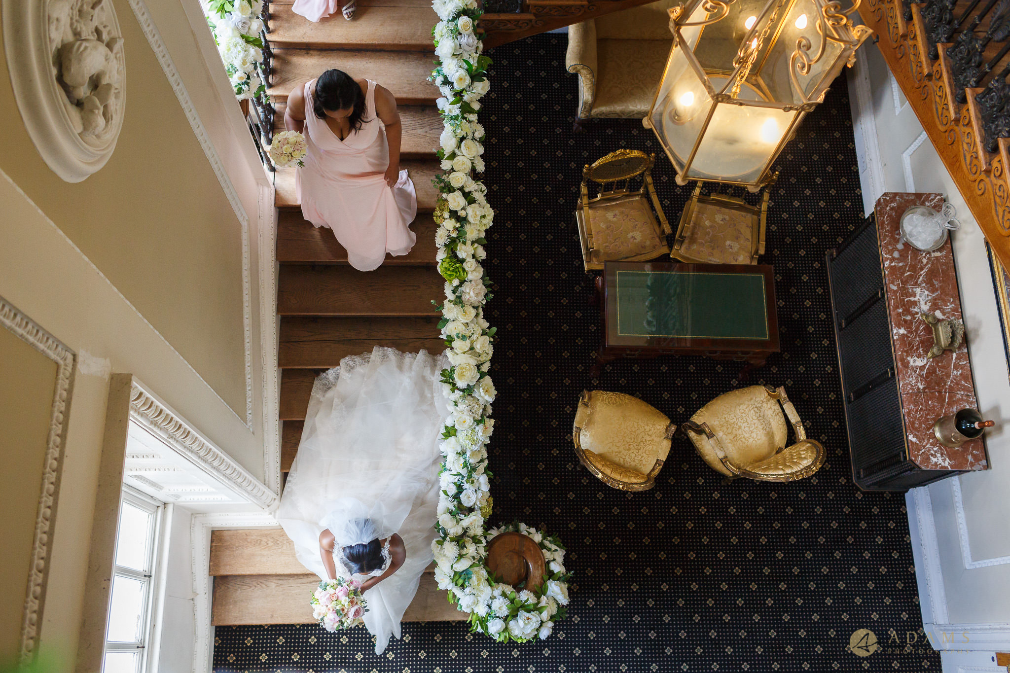 Shot from above of the bride on the stairs