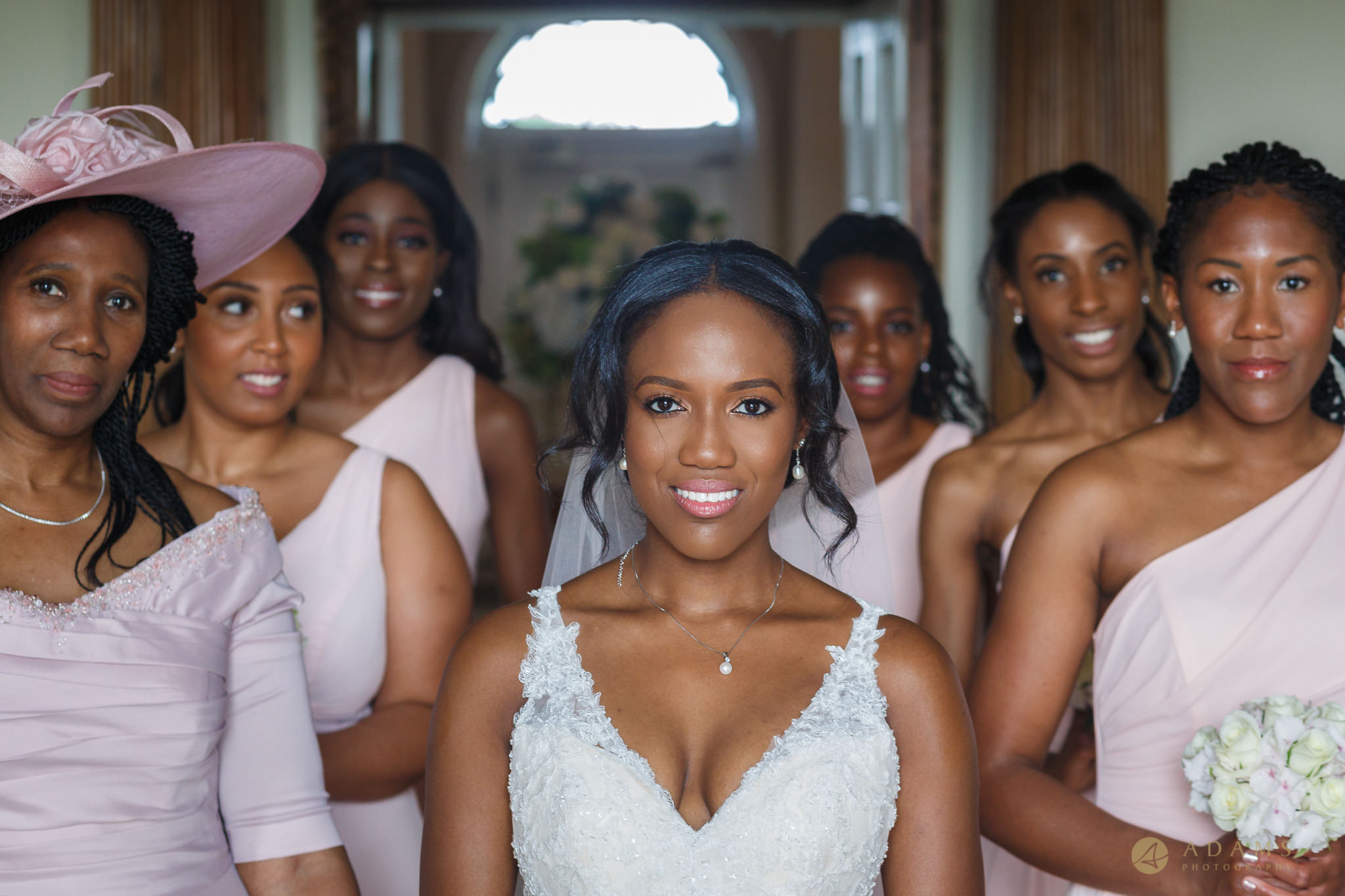 Bride and her bridesmaids posing for a photo